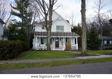 HARBOR SPRINGS, MICHIGAN / UNITED STATES - DECEMBER 25, 2015: A white home East Bluff Drive in Harbor Springs, Michigan.