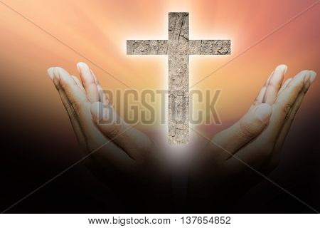 Hands bless the cross in the sky. symbolic representing Jesus