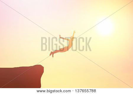 Children jump from a cliff.background of sunset in the evening.
