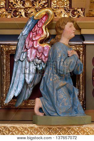 STITAR, CROATIA - NOVEMBER 24: Angel statue on the main altar in the church of Saint Matthew in Stitar, Croatia on November 24, 2015