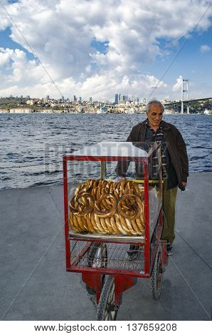 Istanbul Turkey - March 10 2013: A vendor sells simit a type of Turkish bread in the streets of Istanbul.