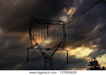 Electric pole with colors sunset and wires