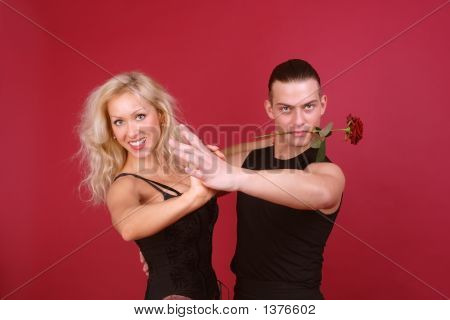 Beautiful Laughing Blondie And Hot Macho With Vinous Rose In His Teeth Dancing Tango