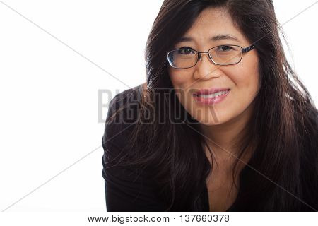 Beautiful Thai Asian woman wearing glasses smiling and wearing black shirt against white background