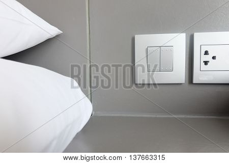 pillows place near the switch in the bedroom