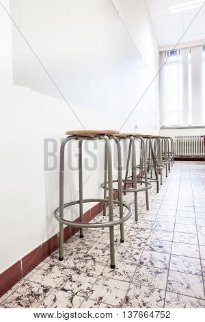 in the school of the university there are an few iron chairs in the auditorium