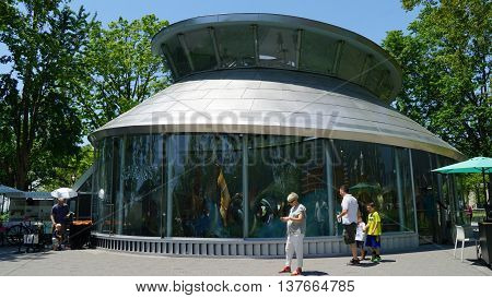 NEW YORK, NY - JUN 19: The SeaGlass Carousel at The Battery Park in New York, as seen on Jun 19, 2016. It is a new, state-of-the-art carousel featuring 30 large, luminescent fish.