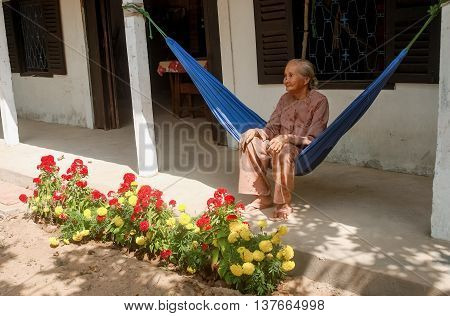BEN TRE, Vietnam, July 3, 2016 woman sitting hammocks, garden party, simple house, Ben tre countryside, Vietnam