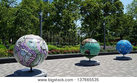 NEW YORK, NY - JUN 19: Cool globes exhibition at Battery Park in Manhattan, New York, as seen on Jun 19, 2016. It is a public art exhibition designed to raise awareness of solutions to climate change.