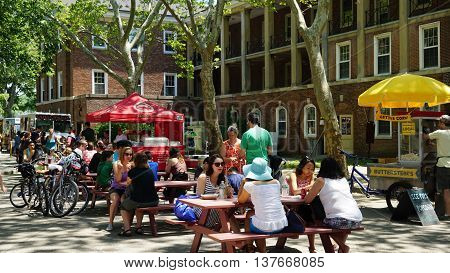 NEW YORK, NY - JUN 19: Food trucks at Governors Island in New York, as seen on Jun 19, 2016. It is a 172-acre island and is part of the borough of Manhattan in New York City.