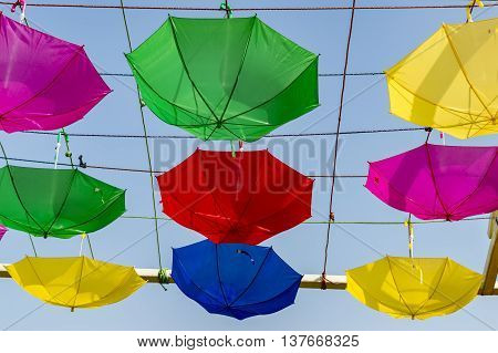 Umbrellas Hanging From Strings In Reverse