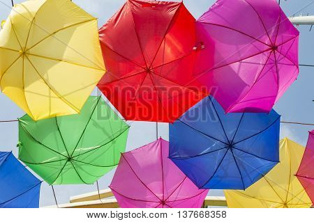 Few upturned umbrellas on display in the sky.
