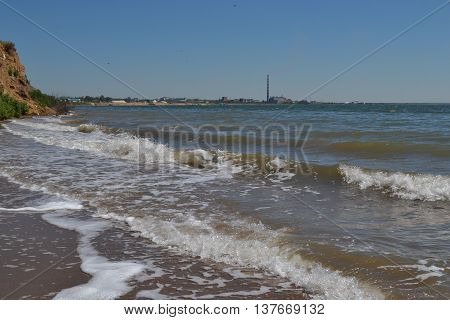 The lake with waves on a windy sunny summer day