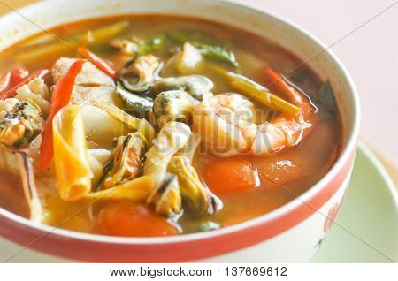 spicy seafood and vegetable soup dish on the table
