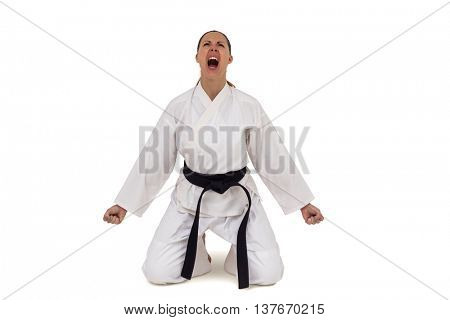 Female fighter posing after victory on white background