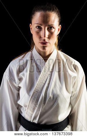 Portrait of female fighter on black background