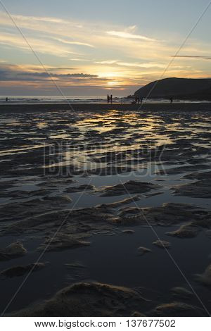 Sunset over Croyde beach North Devon United Kingdom looking towards Baggy Point