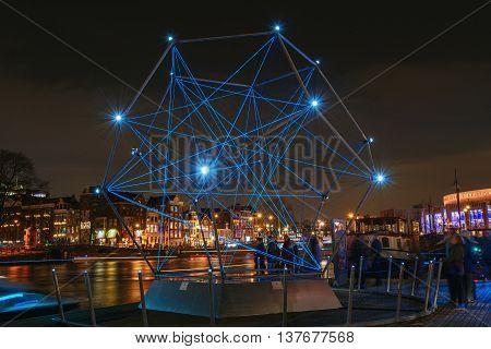 Amsterdam Netherlands - December 18 2015: Light Festival Amsterdam a diamond of light floating on the river The Amstel in Amsterdam