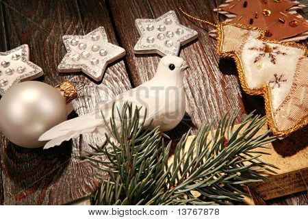 Photo of white pigeon near different christmas objects