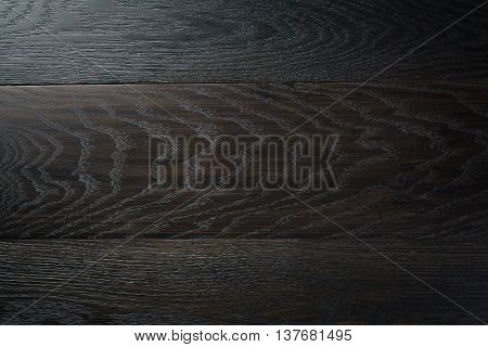 background of natural oak planks covered with black oil, high detailed
