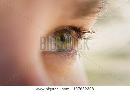 green teen girl eye closeup side view, shallow depth of field