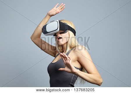 Blonde woman using the virtual reality headset
