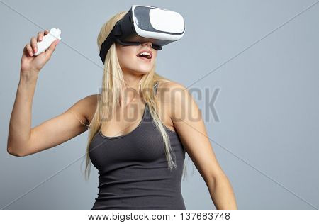 Blonde woman using the virtual reality headset