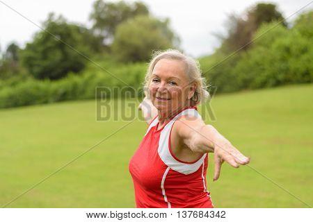 Fit Senior Woman Performing Yoga Exercises