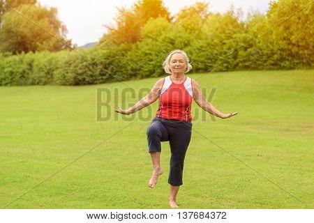 Athletic Senior Woman Performing Balance Exercises