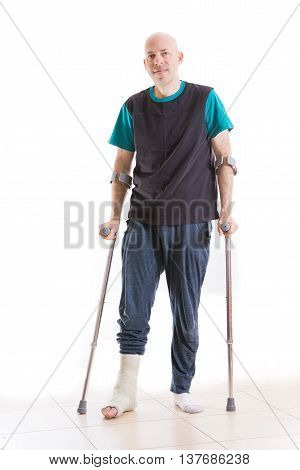 Young Man With A Leg Cast And Crutches