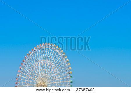 Ferris Wheel with Blue Sky
