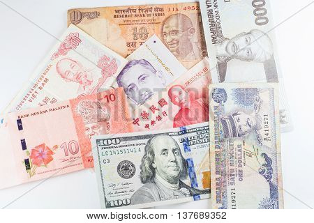 Multiple Currencies banknotes as colorful background showed the global money financial business economy crisis