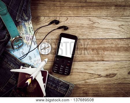 Travel Accessory On Wooden Table