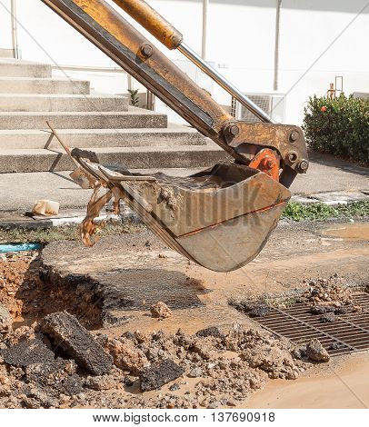 Excavator, bulldozer work a hole the repair of pipe  and motion water sewerage on road