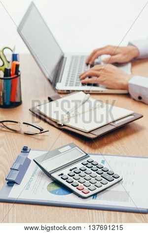 Close up of accountant or banker making calculations. Savings finances and economy concept