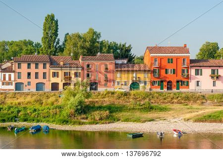 Colored houses along the south bank of river Ticino in Pavia