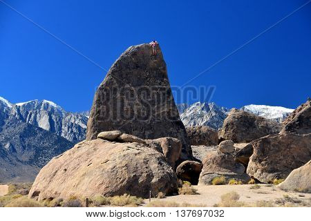 Climber On Sharks Fin Arete Route With Mount Whitney In Back Ground At Alabama Hills , California