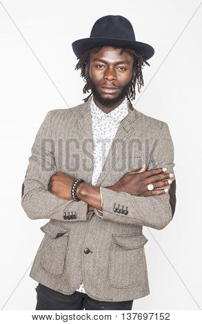 young handsome afro american boy in stylish hipster hat gesturing emotional isolated on white background smiling, lifestyle people concept