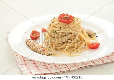 delicious pasta like spaghetti topped with the sauce of sea mantis italy
