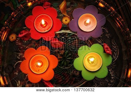 elevated view of floating candle light in glass bowl