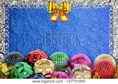 Christmas background with christmas ball and pattern on the blue foil background