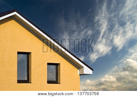 Phorto Of Beautiful House Facade Under Blue Sky