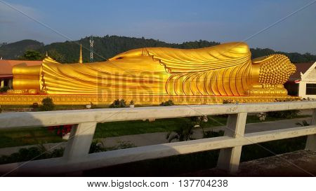 The 99 ft Laem Phor Reclining Buddha, back view, as seen from the highway, Ko Yo Island, Thailand