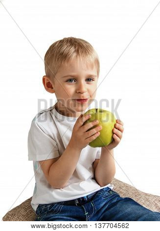 Happy Cheerful Boy Eats The Big Apple, The Child Is The Fruit Green, Soft Focus, Isolated On White B