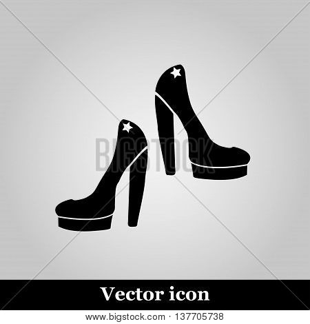 Female shoes icon on grey background, vector illustration