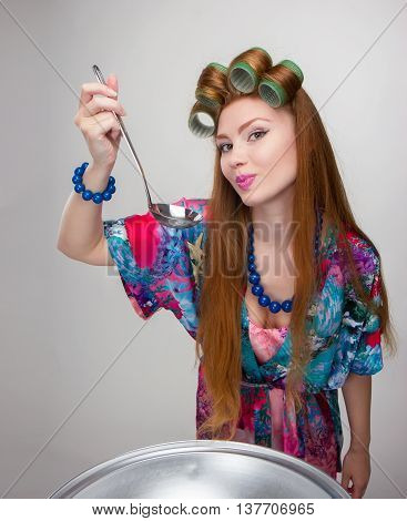 Woman Housewife With Bowls And Pans In A Bathrobe And Curlers Funny Housewife