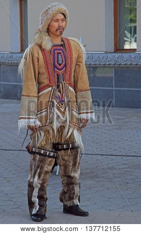Man Of Indigenous Small Numbered People Is Standing Outdoor