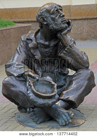 Street Bronze Sculpture Of Beggar With Cap In Chelyabinsk, Russia