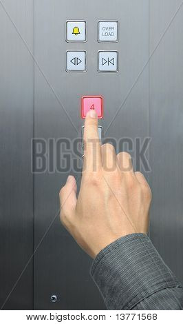 businessman hand press 4 floor in elevator