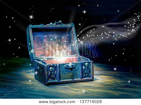 Concept Greeting Card Of Opened Chest Treasure With Mystical Miracle Light On Wooden Background, Bea